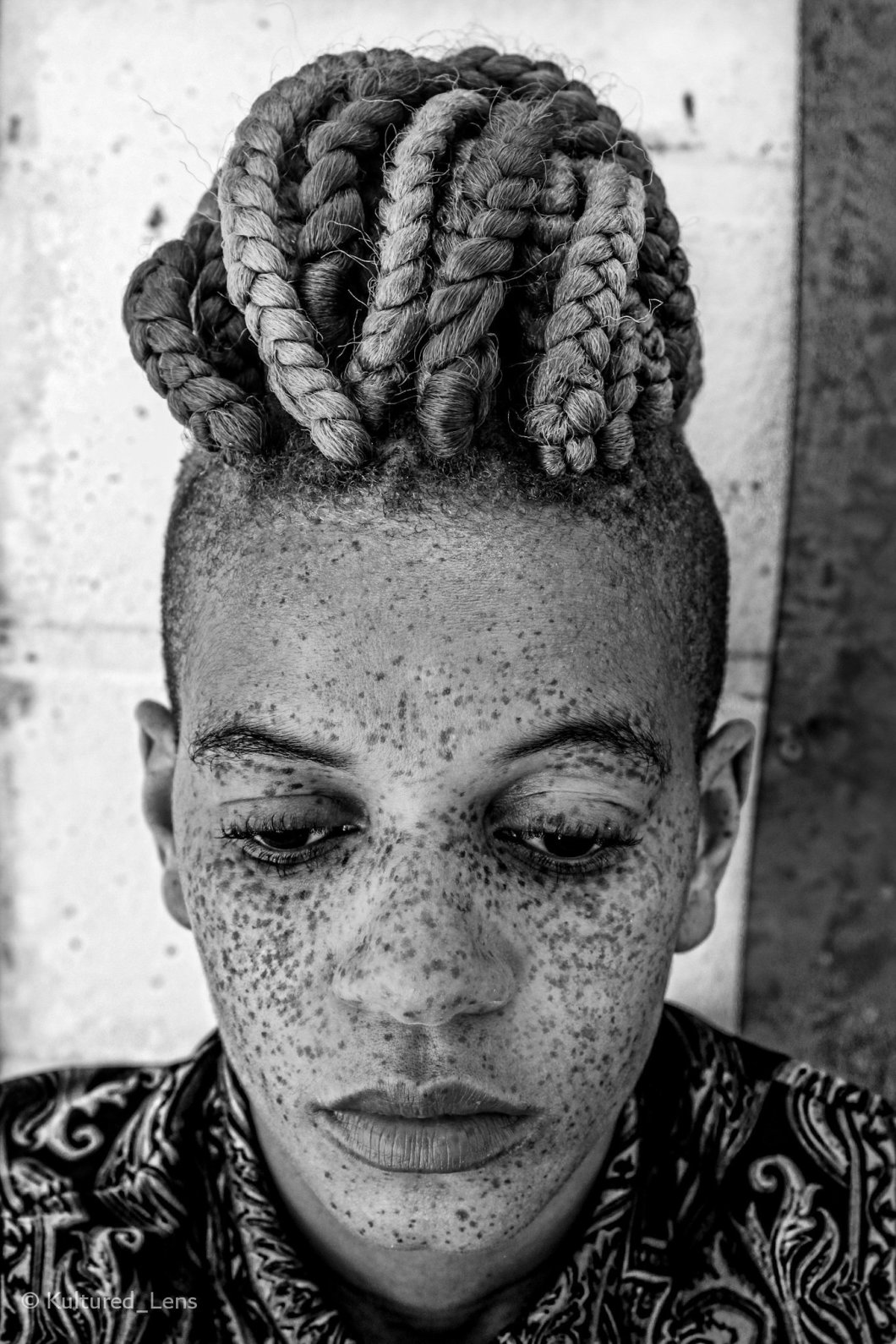 Black and White portrait of a woman of colour with freckles taken by Kultured Lens
