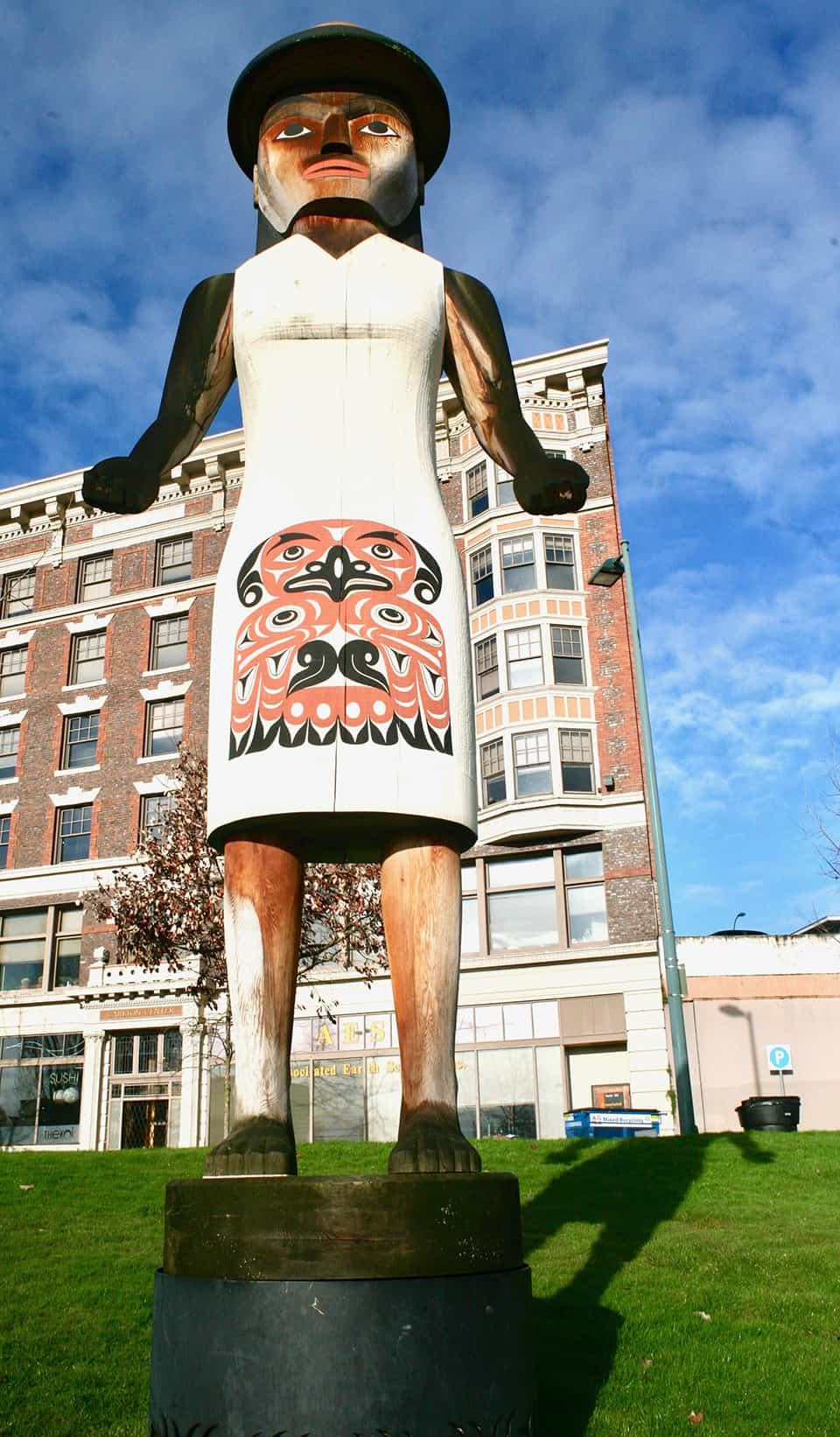 The welcome figure is a masterpiece of native woodcarving towering over Tollefson plaza
