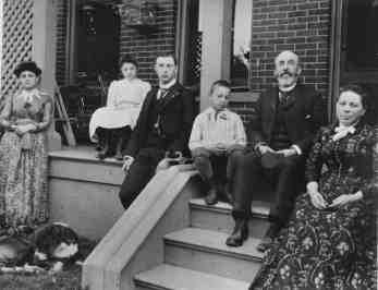 Kirkman family sitting on side porch, Circa 1890