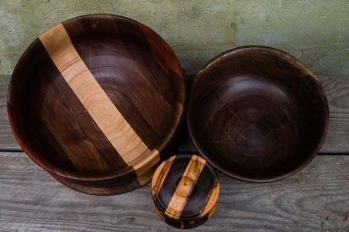 Three finished pieces sit outside John Furniss' - The Blind Woodsman - workshop in Washougal, Washington. The bowls are meant to be used for food.