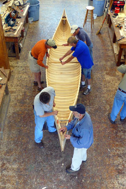Students work on a cedar-and-canvas canoe at the WoodenBoat School in Brooklin, Maine.