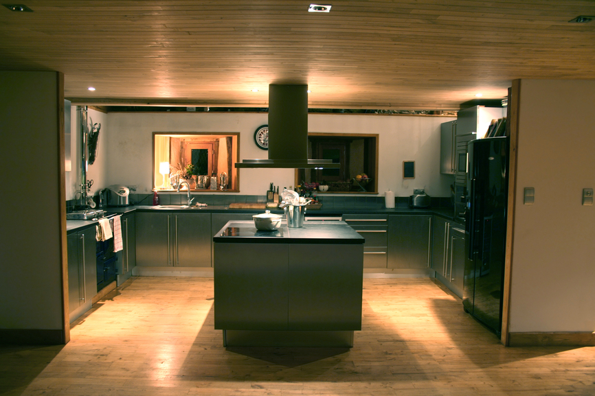 Expensive dark kitchen with ambient lighting