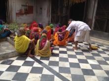 Mohan distributes prasad in Shyamdas' honor in the temple in Jatipura