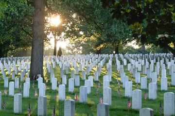At Arlington (Va.) National Cemetery, flags decorate the tombs of those who died in the service of their country. Photo courtesy of Arlington National Cemetery.