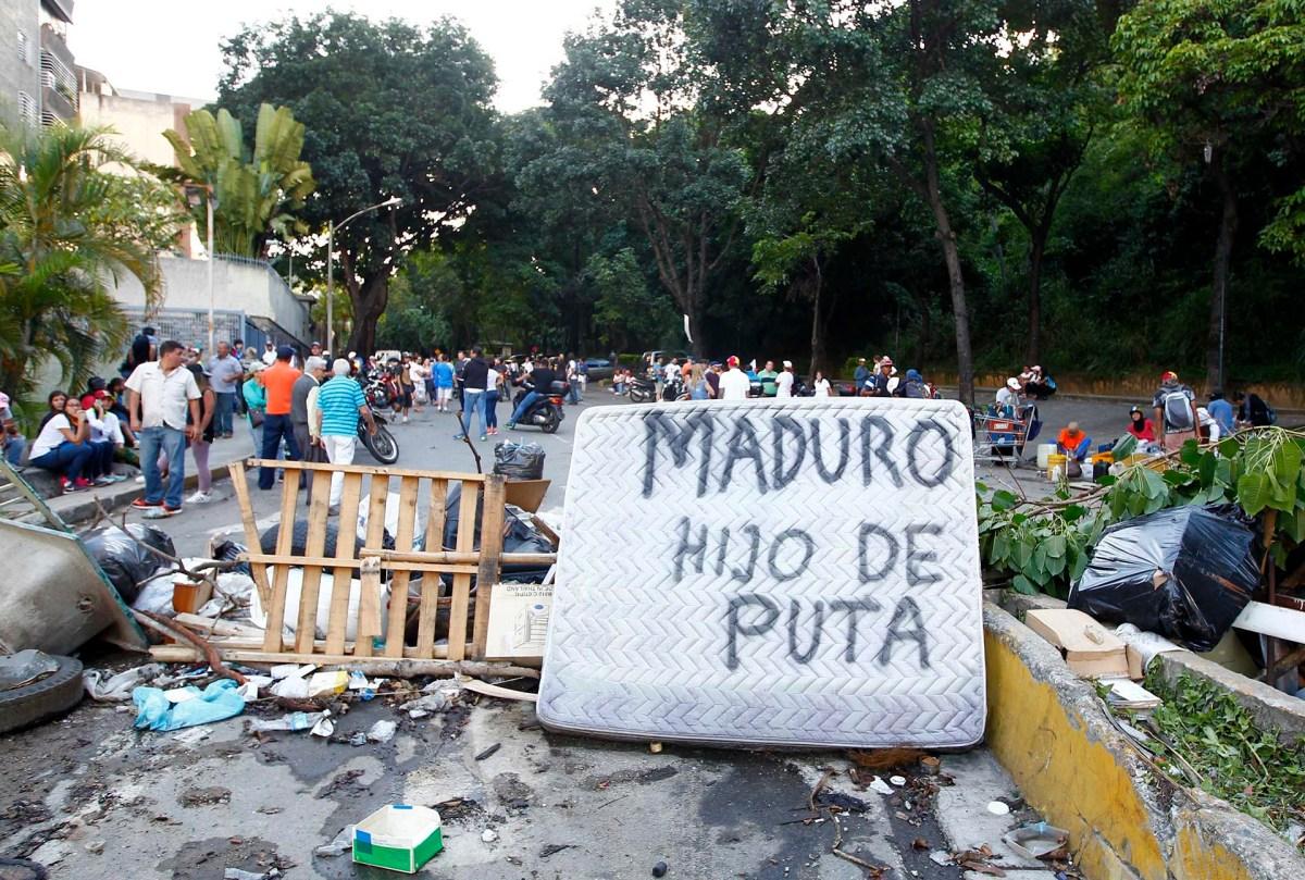 """""""Maduro hijo de puta"""". Las consignas contra el jefe del régimen se multiplicaron en las calles del país (Reuters)"""