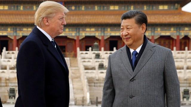 Donald Trump y Xi Jinping, líderes de las potencias mundiales (REUTERS/Jonathan Ernst)