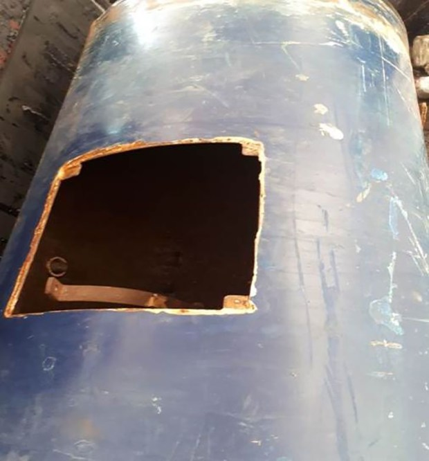 El tanque de gas que contenía las 13 mil municiones tenía una apertura en la parte superior.