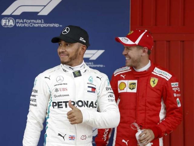 Lewis Hamilton (i)y Sebastian Vettel(EFE)
