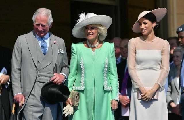 El príncipe Carlos, Camila Parker Bowles y Meghan Markle
