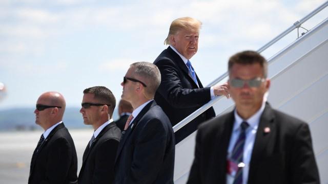 Trump subiendo al avión (AFP)
