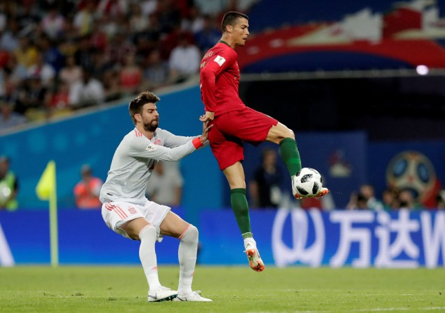 Soccer Football – World Cup – Group B – Portugal vs Spain – Fisht Stadium, Sochi, Russia – June 15, 2018   Portugal's Cristiano Ronaldo in action with Spain's Gerard Pique   REUTERS/Ueslei Marcelino