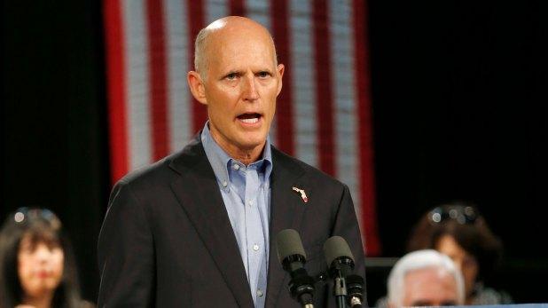 El gobernador saliente Rick Scott.
