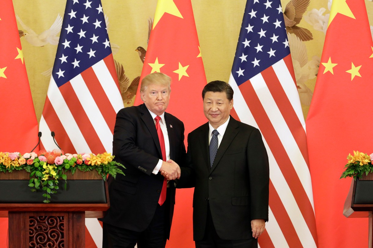 President Donald Trump and Xi Jinping, China's president, shake hands during a news conference at the Great Hall of the People in Beijing on Nov. 9, 2017. MUST CREDIT: Bloomberg photo by Qilai Shen.