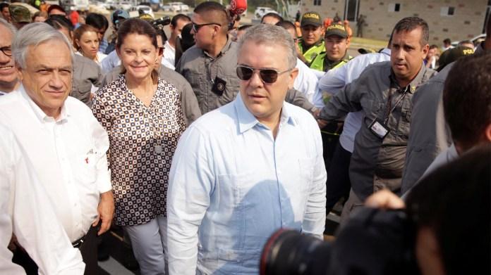 El presidente de Colombia, Ivan Duque, y el presidente de Chile, Sebastián Piñera, llegan al área de un almacén donde se ha recolectado ayuda humanitaria para Venezuela en Cucuta (Reuters)