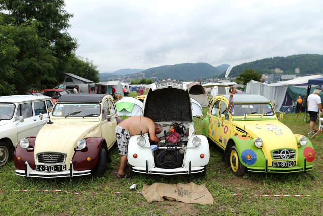 A man works in a Citroen 2CV during dedicated to the iconic Citroen 2CV car in Samobor, Croatia event on August 2, 2019. (Reuters)