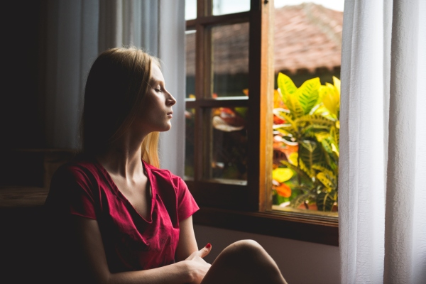 a woman by the window