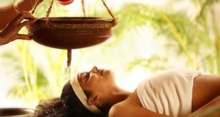 A woman receiving shirodhara, an Ayurvedic bodywork therapy. Ayurveda bodywork is both therapeutic and blissful.
