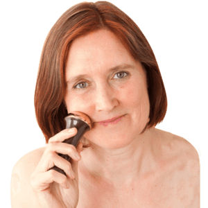 Woman using a Kansa Wand, Ayurvedic Massage tools to know.