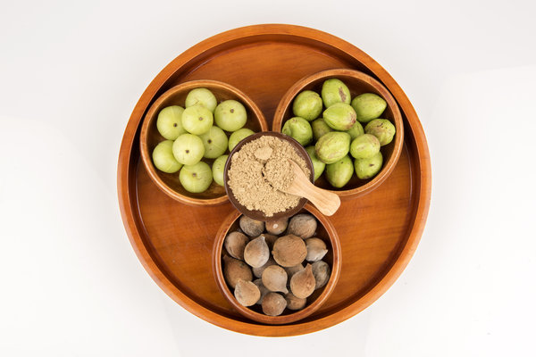 Triphala fruits and Triphala powder. Can Triphala cause bloating?