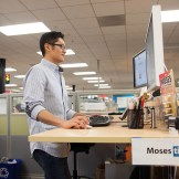 Moses working at his standup desk