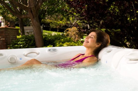 Lower back pain, which affects a majority of Americans at some point in life, may be eased by soaking in a hot tub.