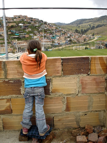 little girl in the slums of Colombia