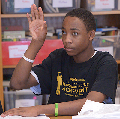 photo of a student raising his hand
