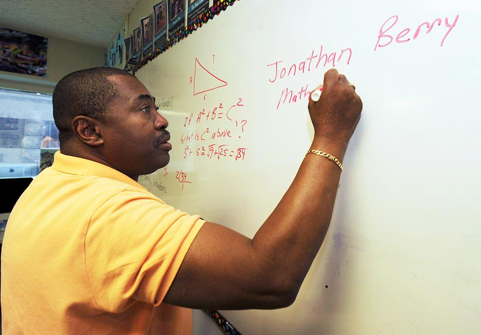 jon berry writing on a whiteboard