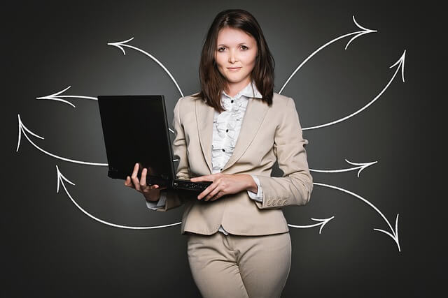 Female entrepreneur holding a laptop