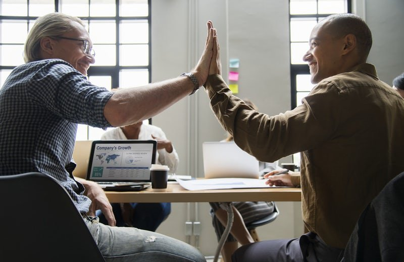 content collaboration people high fiving