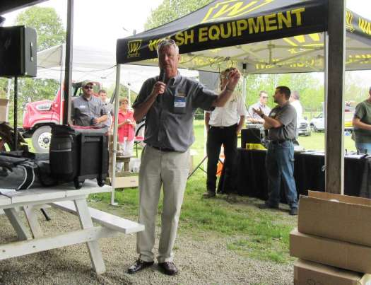 Walsh Equipment's Mike Walsh welcomes attendees to the dealership's regional open house event at the grounds of the Pioneer Steam & Gas Society in Saegertown, Pa.