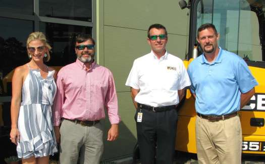 (L-R): Jessica and Chris Shea, Low Country JCB owners, welcome Richard Fox-Marrs, JCB North America president and CEO, and Dusty Zeigler, original founding partner of Low Country Machinery and retired NFL lineman.