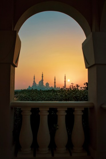 The photogenic arches perfectly frame the Grand Mosque, Abu Dhabi