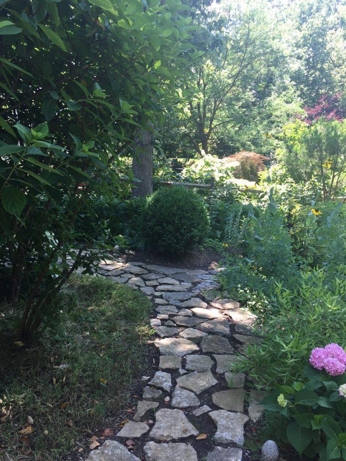 garden path leading to shade garden