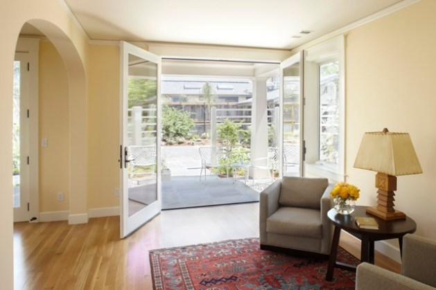 Turning a Basement into an In law Suite  Six Elements of Successful     high French doors on the east wall of this basement in law allow air  light  and people to circulate freely  The taller the doors or windows