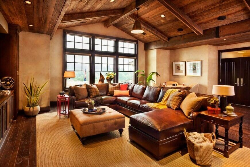 22 Sophisticated Living Rooms with Leather Furniture  DESIGNS  When matched with an all wood rustic arched ceiling  this leather sectional  with a