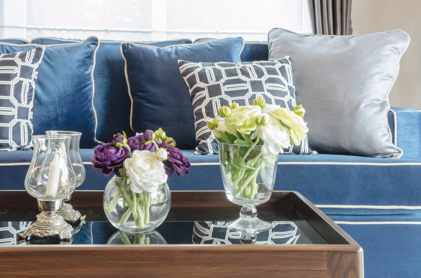 decorative pillow arrangement   My Web Value Sofa pillow arrangements for a cool look  Blue and grey pillows on a blue  sofa