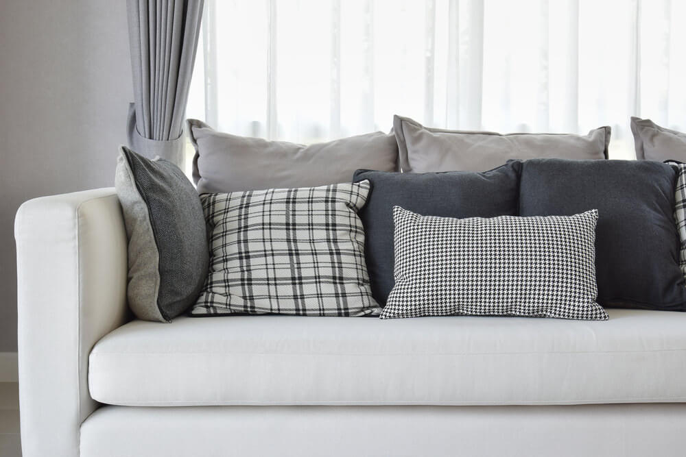 One can't help but love the white sofa with black, grey and white pillows.