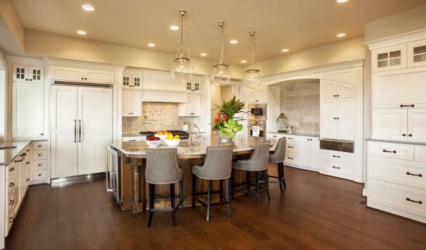 44 Kitchens with Double Wall Ovens  Photo Examples  Elegant white kitchen with large diner style island  The Double wall oven  is centrally