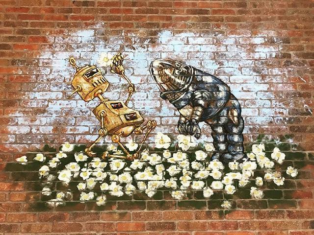 GoogleBot Art On Brick Wall at GooglePlex