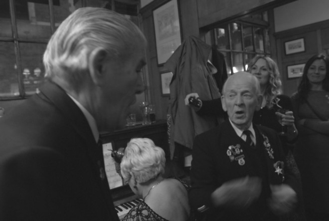 Veterans singing at a recent Music Night at the Coach and Horses in Soho in London