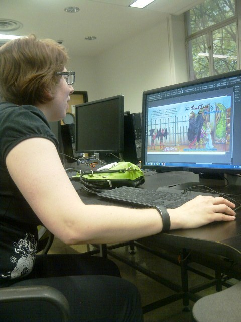 Brienne E. Wright hard at work finalizing the cover.