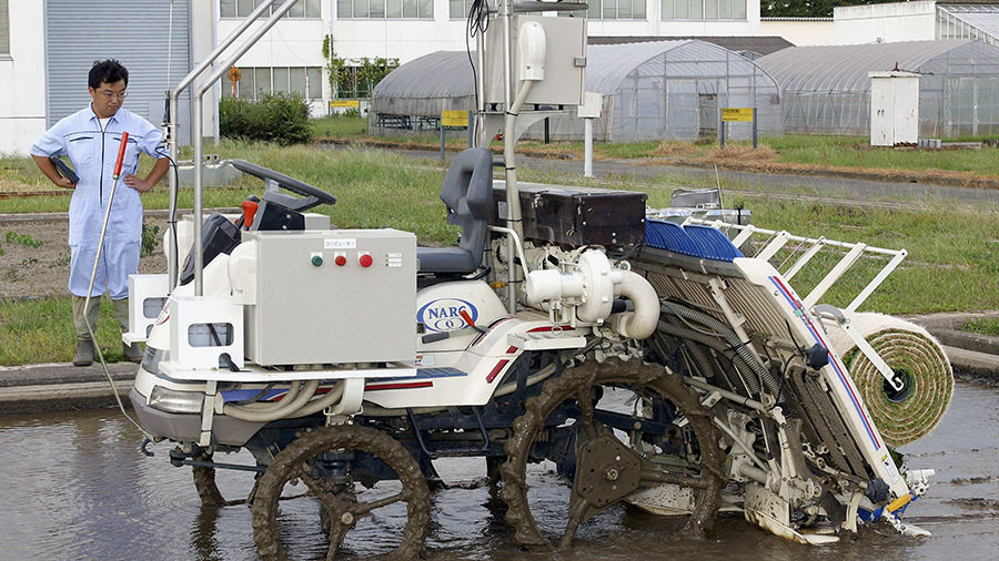 Backbreaking work in the mud replaced by a GPS equipped automated rice planter
