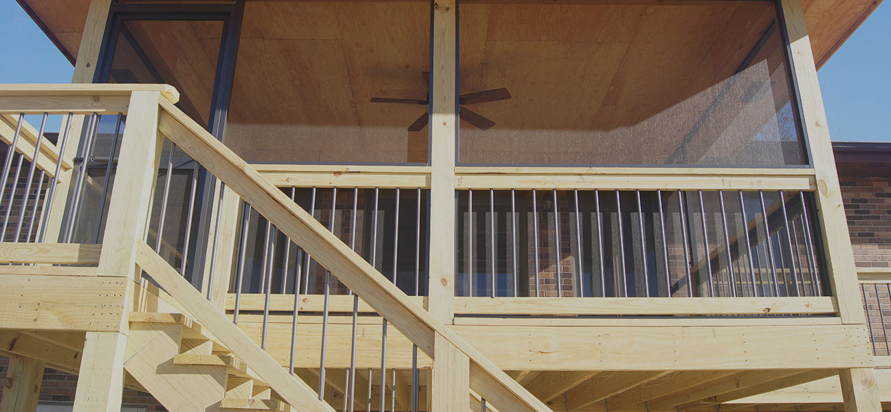 Screened-in porch with new deck construction from TrueSon Exteriors.