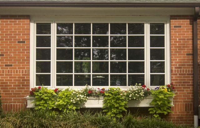 Outside view of large window done by TrueSon Exteriors