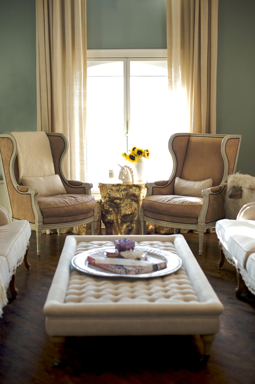 Tufting Design Cream Coffee Table Ottoman with Cream and Tan Wing Back Chairs in Teal Living Room