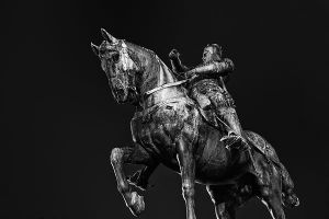 Cityscape | Canvas wall art | for sale | Leeds Black Prince statue against a dark sky (black and white)