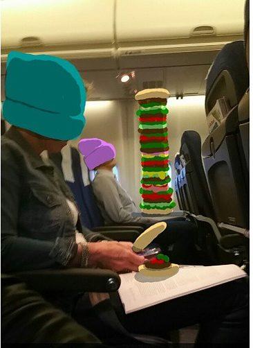 divertidas animaciones de snapchat Comiendo gran hamburgues en un avion
