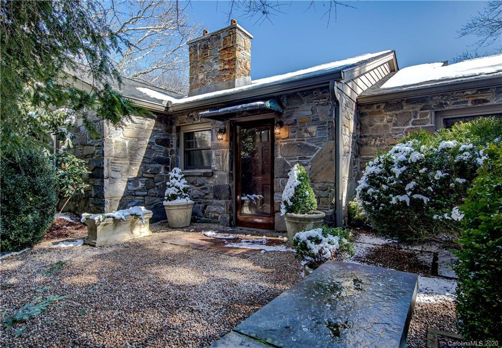 Meander along the enchanting pebble pathway to the entrance of this 1940s stone cottage and prepare to fall in love. Elegantly updated, the integrity of the original architecture remains with the addition of a modern kitchen, strikingly beautiful master bath and guest baths. Expansive rear deck with vaulted ceiling invites you to sit and enjoy the privacy of 4 acres and the beauty of the Blue Ridge Mountain views. This, along with the large living area, dining room and gourmet kitchen allow for ease in entertaining large numbers of friends & family. Elegant 1-bedroom guest home above detached 2-car garage can be used as a short-term vacation rental. Landscape and outdoor lighting were masterfully designed by landscape architect Steven Lee Johnson. In this exceptional home, you will find the perfect balance of luxury, comfort and access to downtown Asheville. An additional 2.1 acre lot was added to this listing. See pin 975021302500.