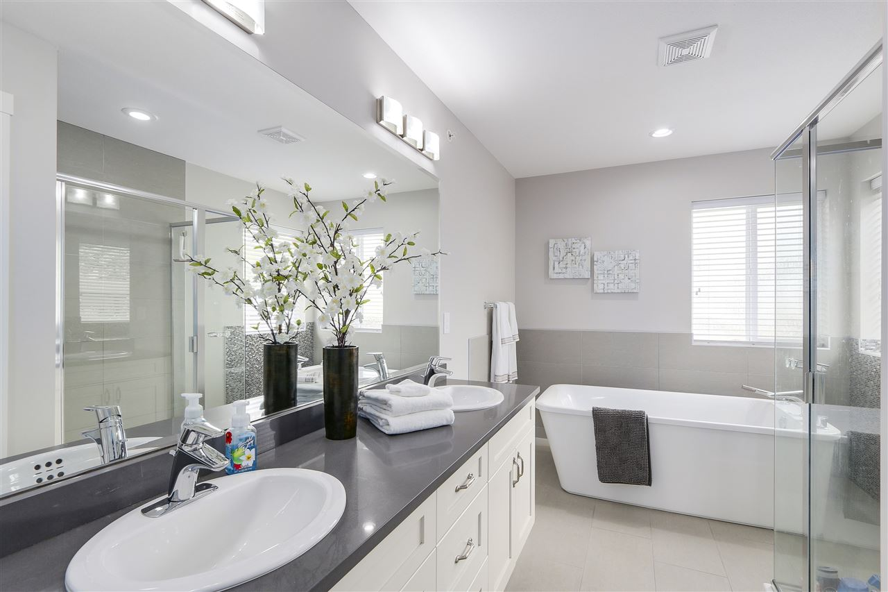 Spa-like master ensuite w/ 4ft shower + free standing standing soaker tub.